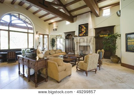 View of spacious living room with beamed ceiling at home