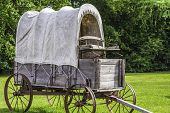 A side view of a stagecoach that was from the 1800s. poster
