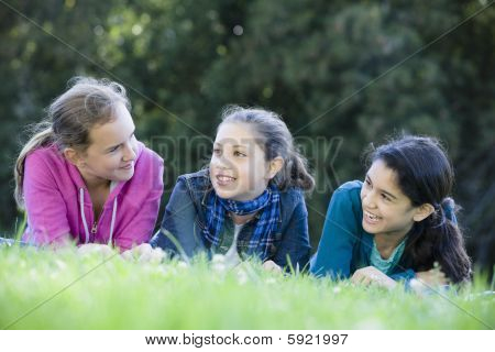 Group Of Tween Girls Lying On Grass