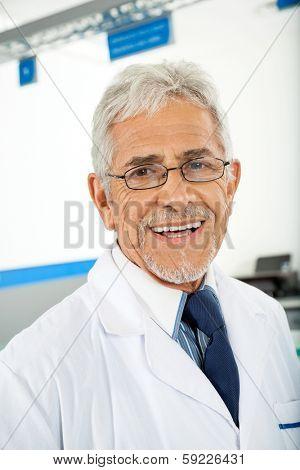 Portrait of smiling male technician in laboratory