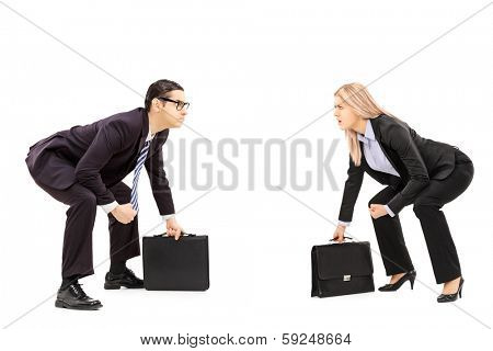 Two business rivals in sumo wrestling stance preparing for a fight isolated on white background