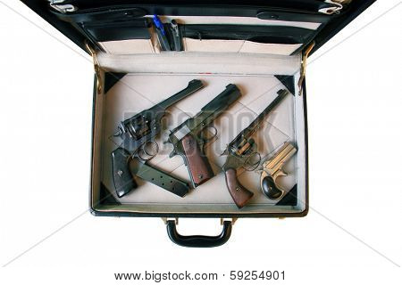 A genuine briefcase filled with Guns. Could be a Hit Man's Arsenal, or a FBI Sting or CIA Mole or a Gun Collector going to a gun show. You decide. The Perfect image for all your need. isolated
