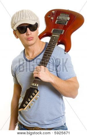Guitarist With Electric Guitar On His Shoulder