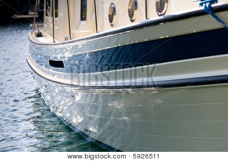 Side Of Boat Shimmering Off The Water