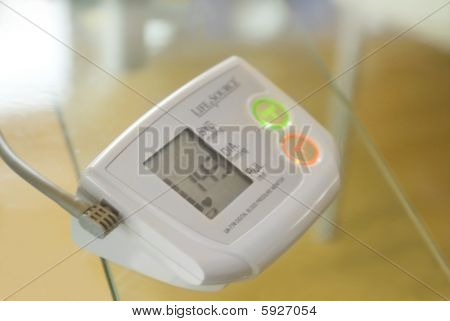 This is a digital blood pressure monitor used by a nurse for health control for an insurance compagny. poster