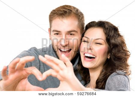 Valentine Couple isolated on white background. Portrait of Smiling Beauty Girl and her Handsome Boyfriend making shape of Heart by their Hands. Happy Joyful Family. Heart Sign. Valentines Day  poster