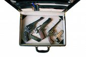 A genuine briefcase filled with Guns. Could be a Hit Man's Arsenal, or a FBI Sting or CIA Mole or a Gun Collector going to a gun show. You decide. The Perfect image for all your need. isolated  poster