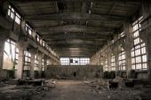 Abandoned Industrial building Interior. Old damaged factory. poster