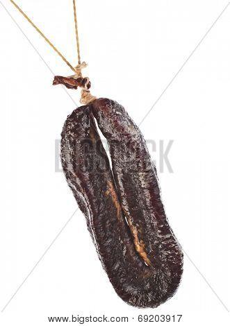 Turkic  sausages sudzhuk isolated on white background