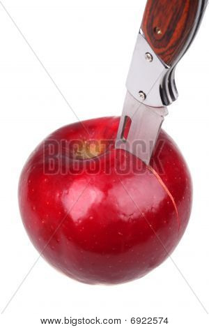 Apple With The Thrust Knife. Close Up.