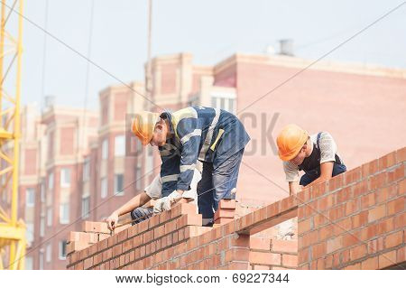 Bricklayers on house construction