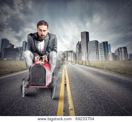 Businessman Driving A Fast Car