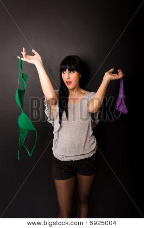 Sexy girl holding underwear
