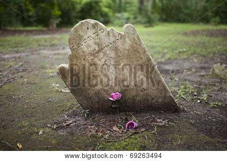 ancient crooked tombstone with room for name on epitaph