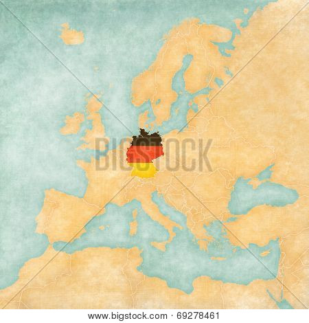 Germany (German flag) on the map of Europe. The Map is in vintage summer style and sunny mood. The map has a soft grunge and vintage atmosphere which acts as watercolor painting on old paper.