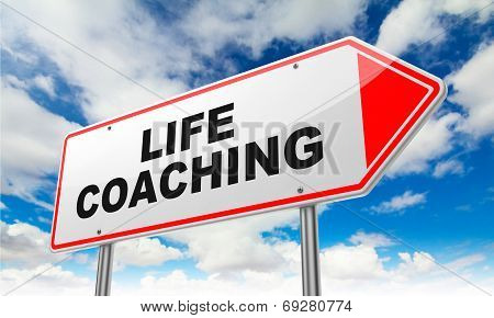 Life Coaching Inscription on Red Road Sign on Sky Background. poster