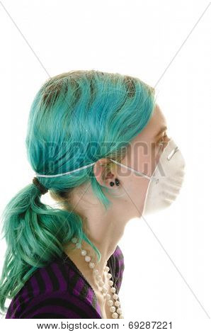 Young woman with medical or air filtration mask on, isolated on white
