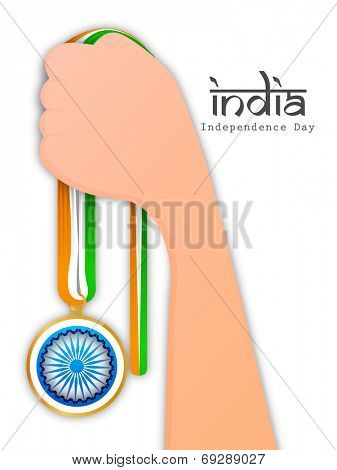Human hand holding badge made by Asoka Wheel and national tricolors ribbon with stylish text India on white background.