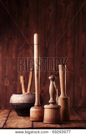 retro potato mashers on old wooden table in rustic style