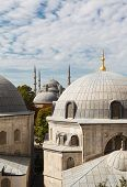 Tomb of Sultan Selim II Murad III and Blue Mosque on background the blue sky on clear day Istanbul Turkey poster