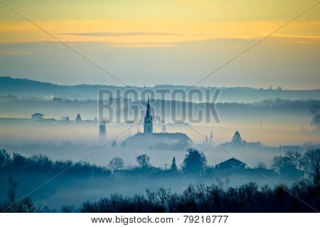 Krizevci Cathedral In Fog Landscape