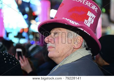 Man in pink hat watching countdown