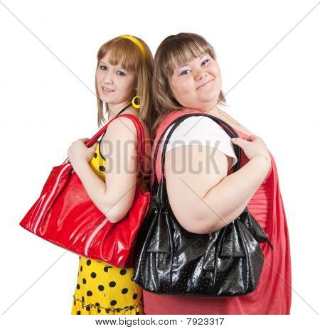 Two casual girls with handbags over white background poster