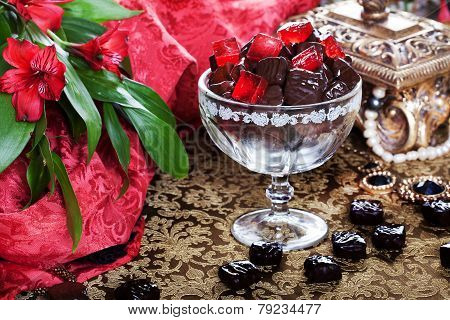 luxury chocolates in a still life with beads and gold casket poster