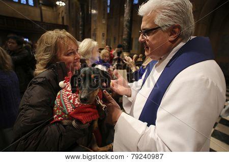 Pastor Stephen Bauman with small dog