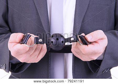 Businessman Holding Ball Gag