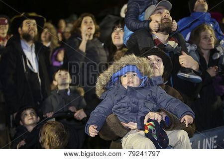 Families watch menorah lighting