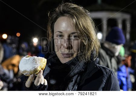 Woman with sufganiyot