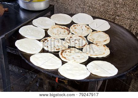 Indian Parrotha Bread Cooking On Hotplate In Marketplace