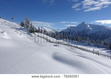 wintry ski area with cable car