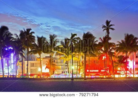 MIAMI BEACH FLORIDA USA-JUNE13: Illuminated hotels and restaurants at sunset on Ocean Drive