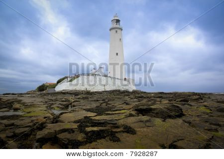 st marys lighthouse in whitley bay on the northeast coast of england first operational in 1898 and decomissioned in 1984 the island is reached at low tide across a causeway poster