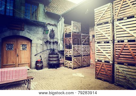 Old winery backyard with empty wooden crates poster
