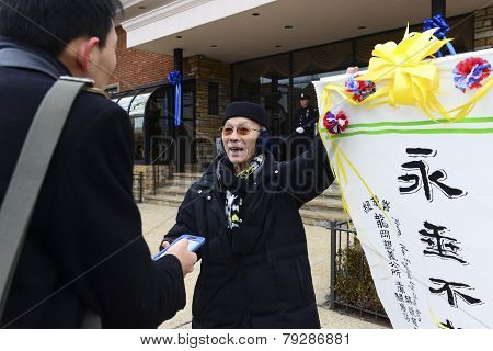 Chinese man with calligraphy banner