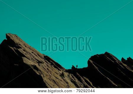 Hiking silhouette on rock formation