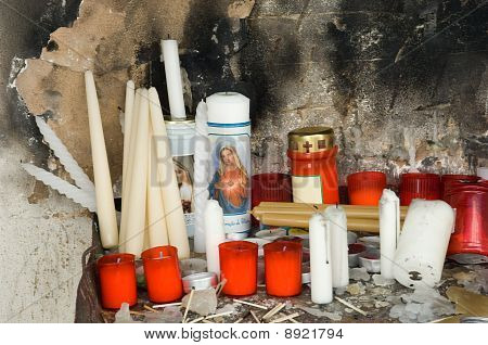 Devotional place  with candles on a graveyard