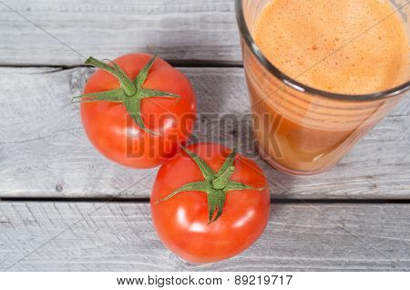 Fresh Tomato Juice With Whole Vegetables Iagainst Wooden Background