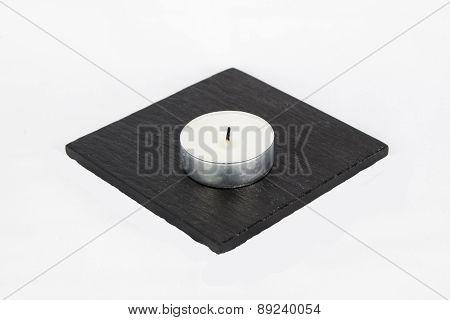 T Light Candle On Stone Coaster, Isolated, White Background.