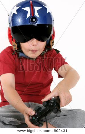 Child In Helmet Playing A Flight Simulator