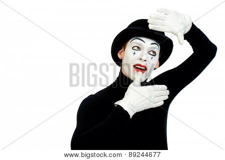 Portrait of a male mime artist. Isolated over white.