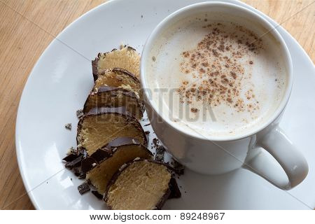 Coffee With Milk Foam And Cocoa To Marzipan In Chocolate
