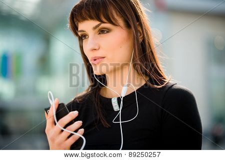 Woman calling phone in street