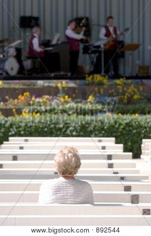 Lone Elderly Woman Watching Jazz