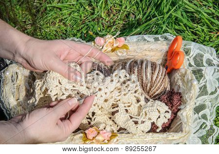 Close-up Of  Woman's Hands Crocheting Outdoors