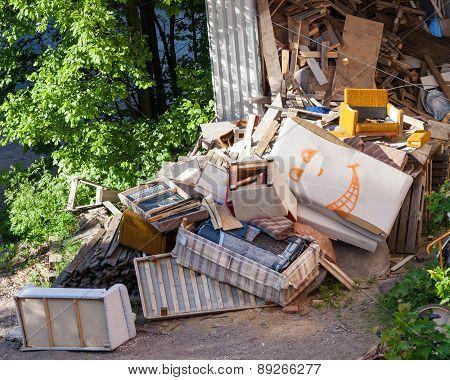 Funny broken furniture trash pile at yard poster