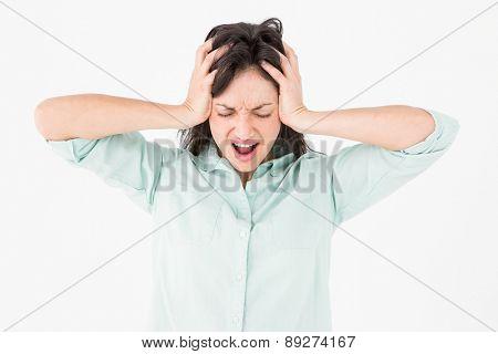 Depressed woman shouting on white background